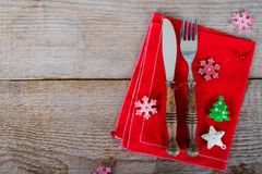 The cutlery on the red napkin. On wood Royalty Free Stock Photos