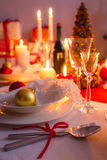 Cutlery with red ribbon on the holiday table Stock Photography