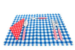 Cutlery and table cloth. Cutlery in red and table cloth in blue Stock Image