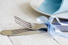 Cutlery and ribbon on old vintage wooden table Stock Photos