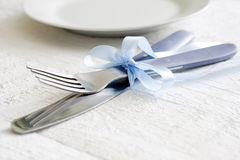Cutlery and ribbon on old vintage wooden table Royalty Free Stock Images