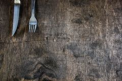 Cutlery on a rustic background. Knife and fork. Cutlery on rustic wood base.Knife and fork Royalty Free Stock Photo