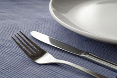 Cutlery Set blue background Stock Photos