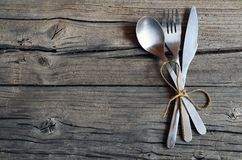 Cutlery set:fork,spoon and knife on rustic wooden table.Cutlery on old wooden background.Can be used as background menu for restau Stock Image