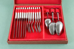 Cutlery set with forks, knifes and spoons in box Stock Photos