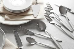 Cutlery set with plates. On gray table royalty free stock photos