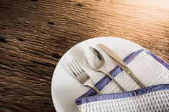 Cutlery set: vintage knife, fork and spoon on white wooden backg Royalty Free Stock Photos