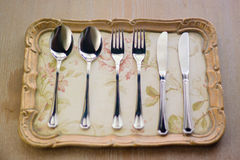 Cutlery set. On a vintage tray on a wooden table Stock Images