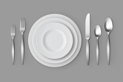 Cutlery Silver Forks Spoons and Knifes with Plates Table Setting Royalty Free Stock Photos
