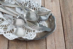 Cutlery on a silver platter. Old cutlery on a silver platter Royalty Free Stock Images