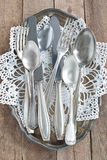 Cutlery on a silver platter. Old cutlery on a silver platter Royalty Free Stock Image