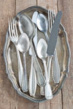 Cutlery on a silver platter. Old cutlery on a silver platter Stock Image