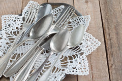 Cutlery on a silver platter. Old cutlery on a silver platter Royalty Free Stock Photography