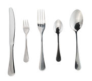 Cutlery silverware or flatware isolated. Cutlery silverware or flatware set of forks, spoons and knife isolated over white background royalty free stock image
