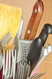 Cutlery in the stand. Royalty Free Stock Photo