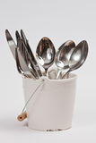 Cutlery stand in a small bucket Royalty Free Stock Photos