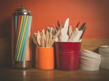 Cutlery straws and plastic lids Royalty Free Stock Image