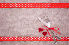 Cutlery on tablecloth view from top. Stock Image