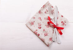 Cutlery, tablecloth on white wooden table for Royalty Free Stock Image