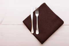 Cutlery, tablecloth on white wooden table for Stock Photo
