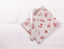 Cutlery, tablecloth on white wooden table for Royalty Free Stock Photo