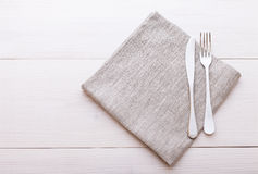 Cutlery, tablecloth on white wooden table for Stock Images