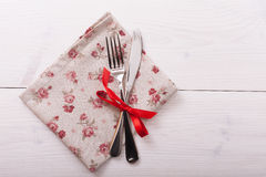 Cutlery, tablecloth on white wooden table for Stock Photography