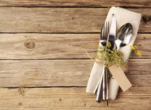 Cutlery Tied on Napkin with Small Leaves and Tag Stock Images
