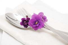 Cutlery with violet Stock Images