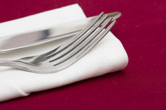 Cutlery on white folded napkin Royalty Free Stock Photo
