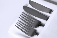 Cutlery and White Linen Stock Photography