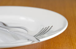 Cutlery on white plate Stock Photography