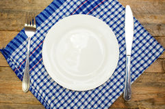 Cutlery and a white plate Stock Photography