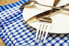 Cutlery and a white plate Royalty Free Stock Photography