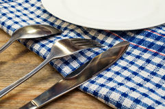 Cutlery and a white plate Stock Photo