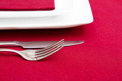 Cutlery and white squre plates Royalty Free Stock Photography
