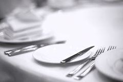 Cutlery on white table Royalty Free Stock Images