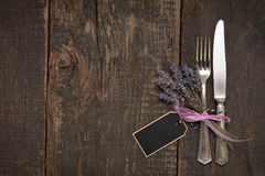 Cutlery on a wooden table with lavender Royalty Free Stock Photos