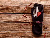 Cutlery Wrapped in Napkin on Wooden Table Royalty Free Stock Photography