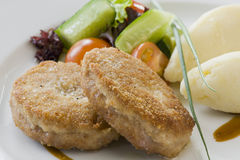 Cutlet And Potatoes With Vegetables Stock Photo