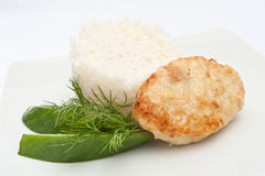 Cutlet. Appetizing cutlet with garnish on a white plate Royalty Free Stock Photo