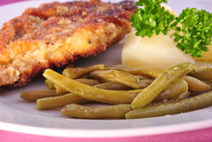 Cutlet with beans and cooked potato Royalty Free Stock Image