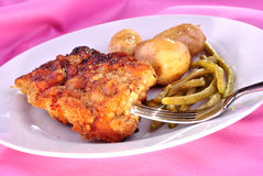 Cutlet with beans and cooked potato Stock Photography
