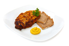 Cutlet with bread, mustard and parsley Royalty Free Stock Image