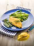 Cutlet breaded with maize flour Stock Images