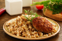 Cutlet with buckwheat with mushrooms. Royalty Free Stock Images
