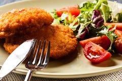 Cutlet Cordon Bleu with salad Royalty Free Stock Photos