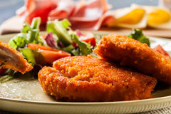 Cutlet Cordon Bleu with salad Royalty Free Stock Photo