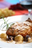 Cutlet with dressing and grapes Stock Images
