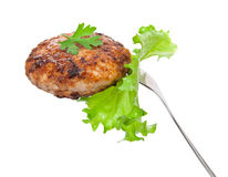 Cutlet on a fork Stock Photos